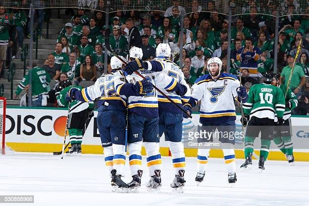 Kevin Shattenkirk Patrik Berglund Colton Parayko and David Backes of the St Louis Blues celebrate a goal against the Dallas Stars in Game Seven of...