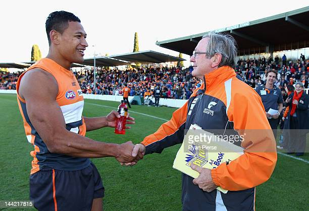 Kevin Sheedy coach of the Giants and Israel Folau of the Giants celebrates the Giants first AFL victory after the round seven AFL match between the...