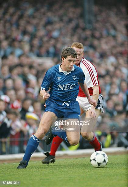 Kevin Sheedy of Everton is challenged by Perry Groves during a match against Arsenal at Highbury on March 31 1990 in London England
