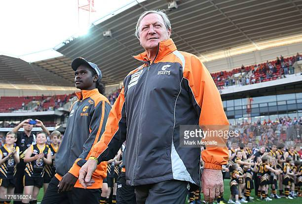 Kevin Sheedy walks onto the field for his last match in Sydney as Head Coach of the Giants before the round 22 AFL match between the Greater Western...