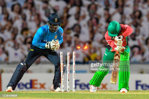 Kevin Sinclair of Guyana Amazon Warriors dismissed by Andre Fletcher of St Lucia Zouks during the Hero Caribbean Premier League Play-Off match 32...