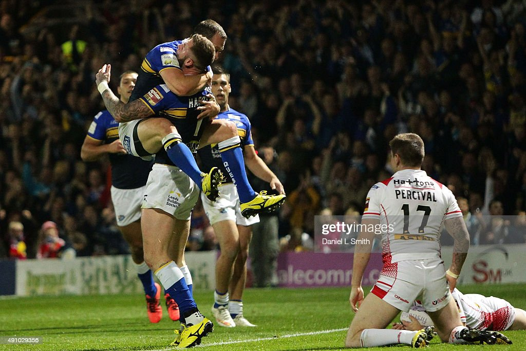 Kevin Sinfield (c) and Zak Hardaker of Leeds Rhinos celebrate after scoring a try during the First Utility Super League Semi Final between Leeds Rhinos and St Helens at Headingley Carnegie Stadium on October 2, 2015 in Leeds, England.