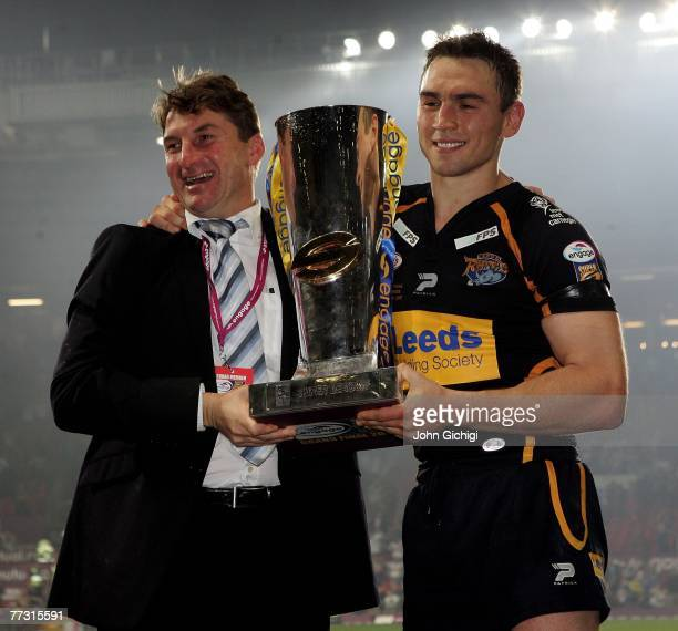 Kevin Sinfield, captain of Leeds Rhinos celebrates with coach Tony Smith after winning the engage Super League Grand Final between St. Helens and...