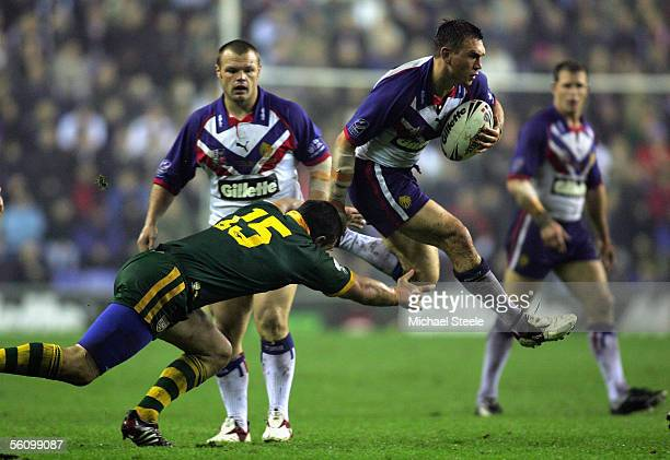 Kevin Sinfield of Great Britain leaps the challenge of Jason Ryles of Australia during the Gillette TriNations match between Great Britain and...