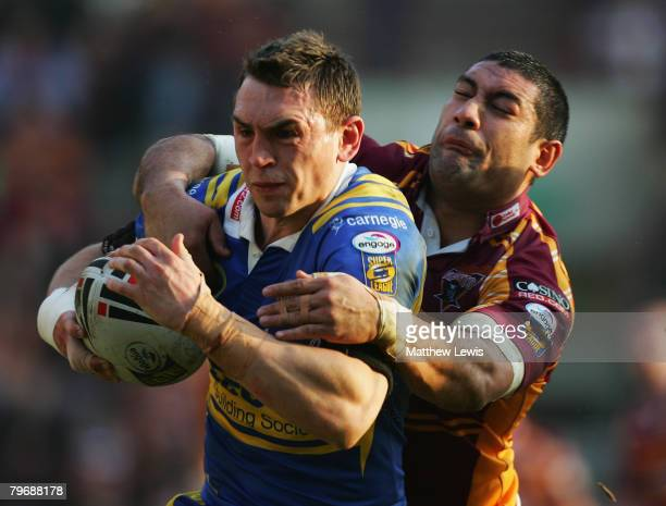 Kevin Sinfield of Leeds is tackled by Jamahl Lolesi of Huddersfield during the engage Super League match between Huddersfield Giants and Leeds Rhinos...