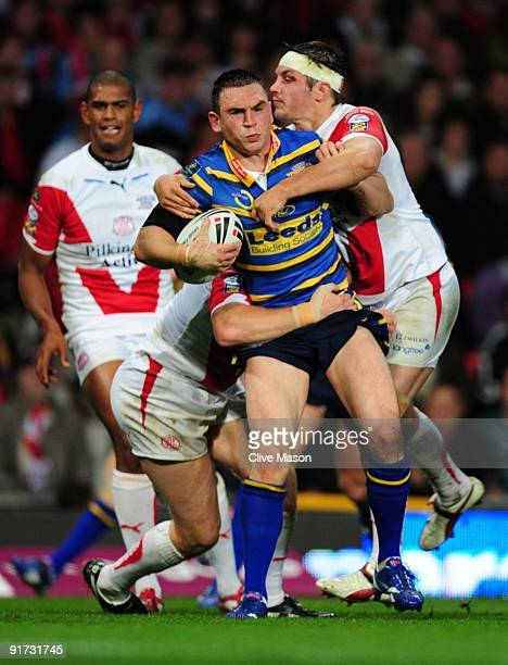 Kevin Sinfield of Leeds Rhinos holds off the St Helens defence during the Engage Super League Grand Final between Leeds Rhinos and St Helens at Old...