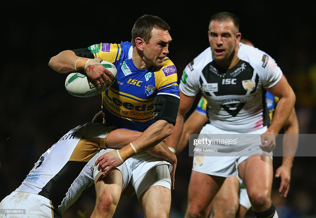 Kevin Sinfield of Leeds Rhinos is tackled by Daniel Holdsworth of Hull FC during the Stobart Super League match between Leeds Rhinos and Hull FC at Headingley Carnegie Stadium on February 1, 2013 in Leeds, England.