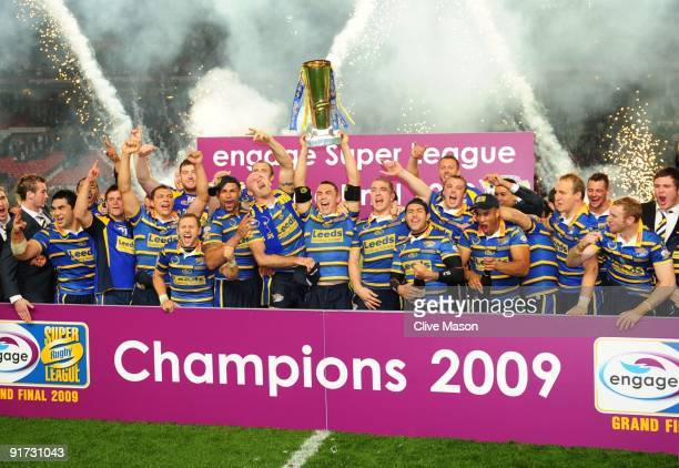 Kevin Sinfield of Leeds Rhinos lifts the trophy after winning during the Engage Super League Grand Final between Leeds Rhinos and St Helens at Old...