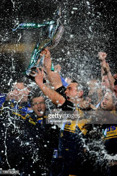 Kevin Sinfield of Leeds Rhinos lifts the trophy following his team's victory at the end of the World Club Challenge match between Leeds Rhinos and...