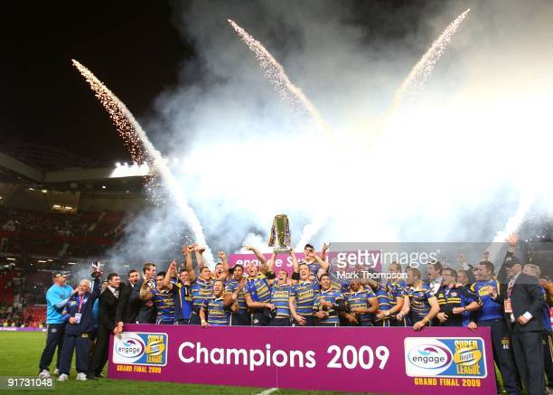 Kevin Sinfield of Leeds Rhinos lifts the trophy with team mates after the Engage Super League Grand Final between Leeds Rhinos and St Helens at Old...