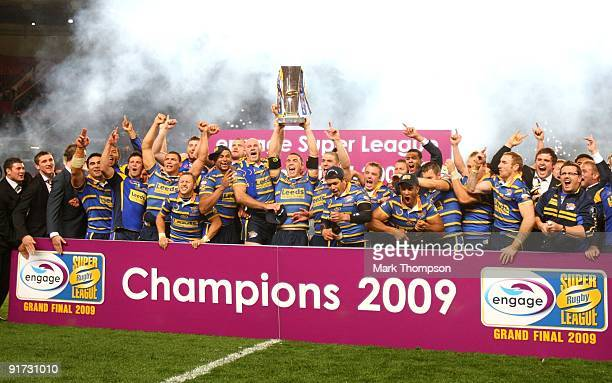 Kevin Sinfield of Leeds Rhinos lifts the trophy with team mates during the Engage Super League Grand Final between Leeds Rhinos and St Helens at Old...