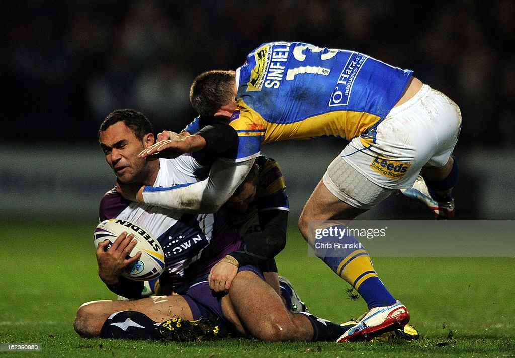 Kevin Sinfield of Leeds Rhinos tackles Justin O'Neill of Melbourne Storm during the World Club Challenge match between Leeds Rhinos and Melbourne Storm at Headingley Carnegie Stadium on February 22, 2013 in Leeds, England.