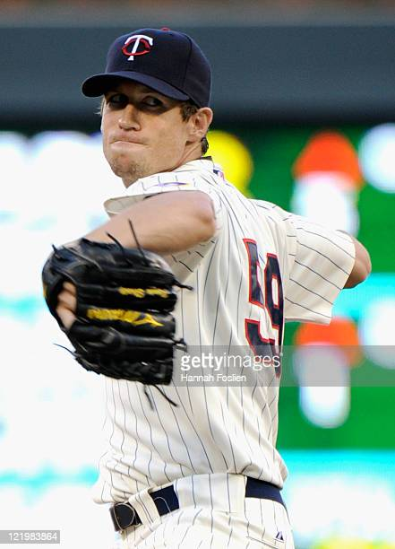 Kevin Slowey of the Minnesota Twins delivers a pitch against the Baltimore Orioles in the first inning on August 24 2011 at Target Field in...