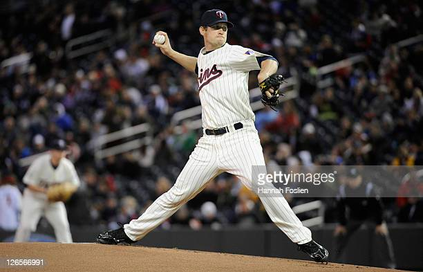 Kevin Slowey of the Minnesota Twins delivers a pitch against the Seattle Mariners on September 21 2011 at Target Field in Minneapolis Minnesota