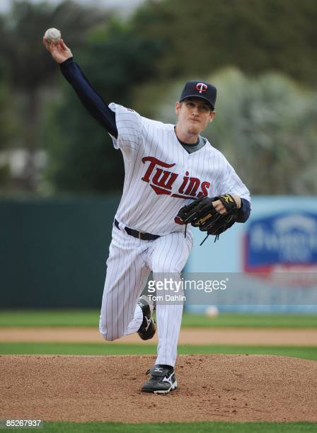 Kevin Slowey of the Minnesota Twins delivers a pitch during a Grapefruit League Spring Training Game against the Boston Red Sox at Hammond Stadium on...