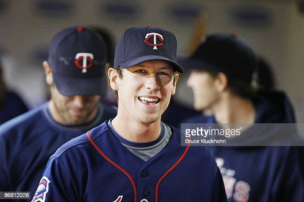 Kevin Slowey of the Minnesota Twins smiles in the dugout after a home run gives him the lead against the Kansas City Royals on May 1, 2009 at the...