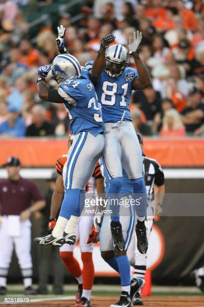 Kevin Smith and Calvin Johnson of the Detroit Lions celebrate during the NFL game against the Cincinnati Bengals at Paul Brown Stadium on August 17,...