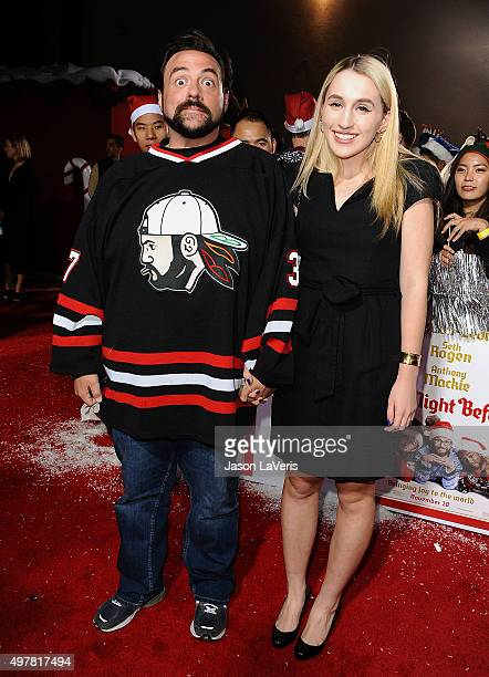 Kevin Smith and Jennifer Schwalbach Smith attend the premiere of The Night Before at The Theatre At The Ace Hotel on November 18 2015 in Los Angeles...