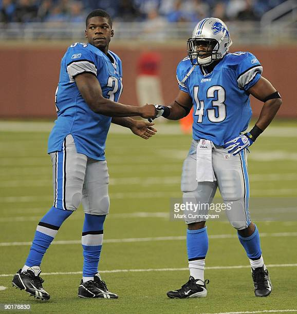 Kevin Smith and Tristan Davis of the Detroit Lions shake hands after a play against the Indianapolis Colts at Ford Field on August 29, 2009 in...