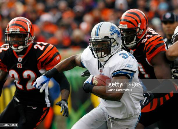 d582bad30 Kevin Smith of the Detroit Lions breaks free from Johnathan Joseph and  Robert Geathers of the