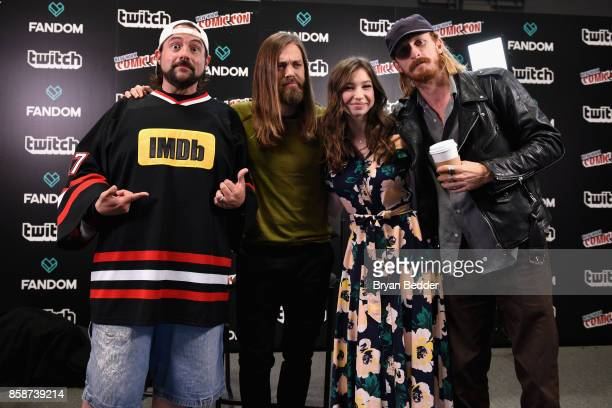 Kevin Smith poses with Tom Payne Katelyn Nacon Austin Amelio of The Walking Dead onstage during IMDb LIVE at NY ComicCon at Javits Center on October...