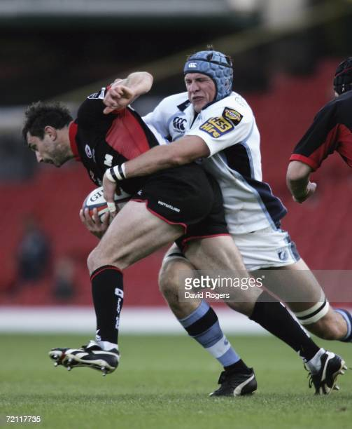 Kevin Sorrell of Saracens is tackled by Scott Morgan during the EDF Energy Cup match between Saracens and Cardiff Blues at Vicarage Road on October 8...