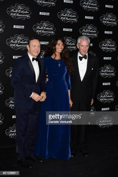 MILAN ITALY NOVEMBER Kevin Spacey Afef Jnifen Marco Tronchetti Provera attend the Pirelli Calendar 50th Anniversary Red Carpet on November 21 2013 in...