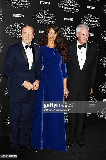 Kevin Spacey Afef Jnifen Marco Tronchetti Provera attend the Pirelli Calendar 50th Anniversary event on November 21 2013 in Milan Italy