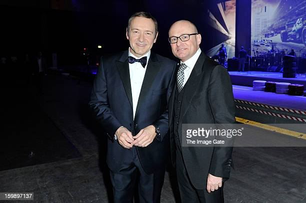 Kevin Spacey and Georges Kern attend the IWC Schaffhausen Race Night event during the Salon International de la Haute Horlogerie 2013 at Palexpo on...