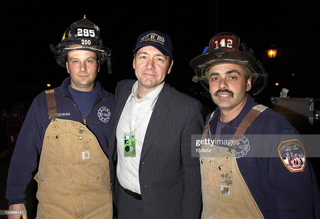 Kevin Spacey and New York City firefighters during MTV's Rock and Comedy Concert - Backstage at Battery Park in New York City, New York, United States.