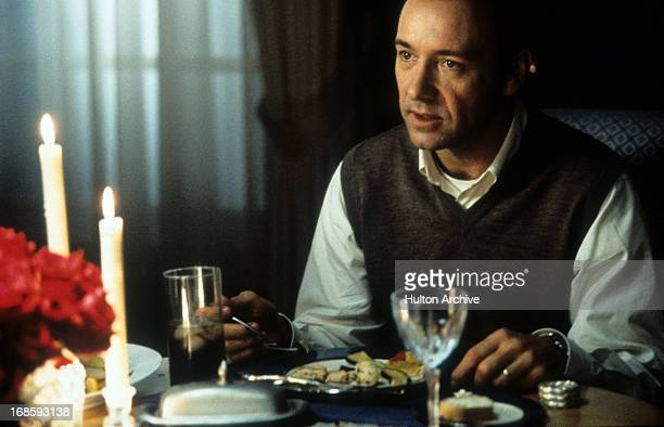 Kevin Spacey eating at a dinner table in a scene from the film 'American Beauty' 1999