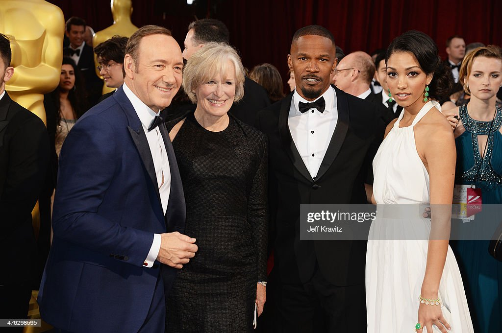 Kevin Spacey, Glenn Close, Jamie Foxx, and Corinne Foxx attend the Oscars held at Hollywood & Highland Center on March 2, 2014 in Hollywood, California.