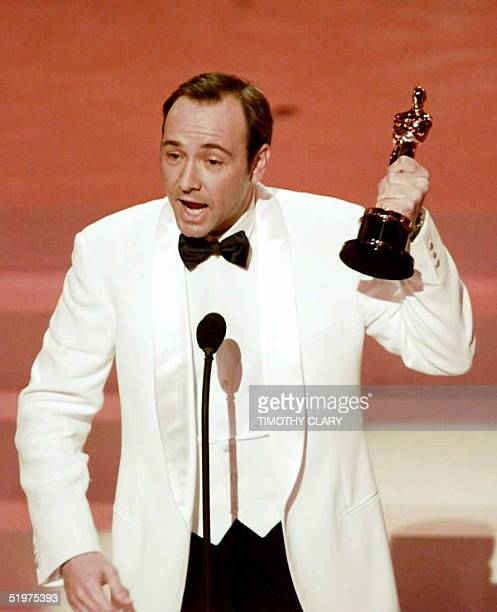 """Kevin Spacey holds up his Oscar after winning Best Supporting Actor for his role in """"The Usual Suspects"""" at the 68th Academy Awards 25 March at the..."""
