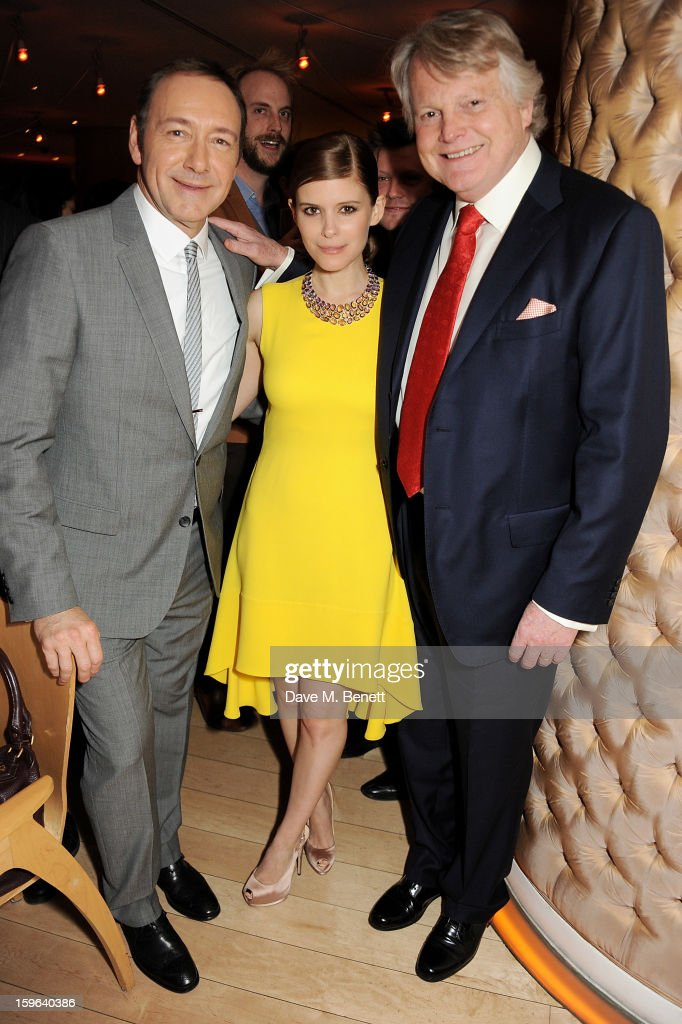 (L to R) Kevin Spacey, Kate Mara and Lord Michael Dobbs attend an after party celebrating the Red Carpet Premiere of the Netflix original series 'House of Cards' at Asia de Cuba, St Martins Lane Hotel, on January 17, 2013 in London, England.