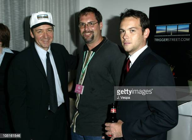 Kevin Spacey Sam Cazzo and Dana Brunetti during 2003 Toronto International Film Festival Budweiser/TriggerStreetcom Party at Lobby in Toronto Ontario...