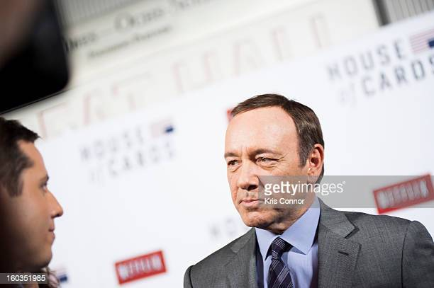 Kevin Spacey speaks with members of the press on the red carpet during the Netflix's 'House Of Cards' Washington DC Screening at NEWSEUM on January...