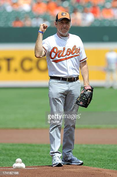 Kevin Spacey throws out the opening pitch before the game between the Baltimore Orioles and the Toronto Blue Jays at Oriole Park at Camden Yards on...
