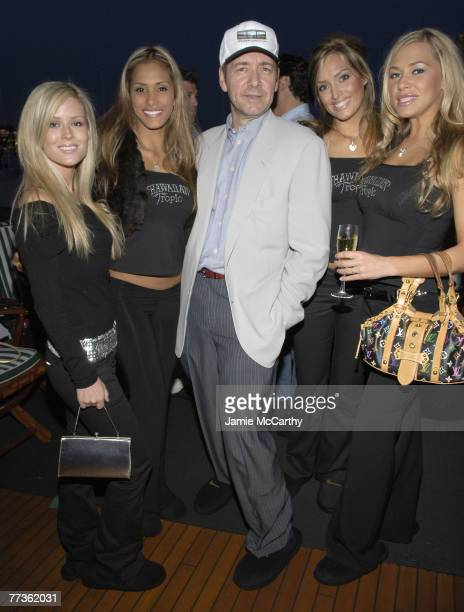Kevin Spacey with Hawaiian Tropic Models