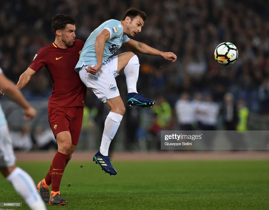 Kevin Srootman of AS Roma and Stefan Radu of SS Lazio in action during the serie A match between SS Lazio and AS Roma at Stadio Olimpico on April 15, 2018 in Rome, Italy.