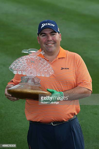 Kevin Stadler poses with the championship trophy after winning the Waste Management Phoenix Open at TPC Scottsdale on February 2 2014 in Scottsdale...