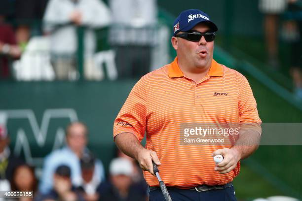 Kevin Stadler reacts on 18th hole during the final round of the Waste Management Phoenix Open at TPC Scottsdale on February 2 2014 in Scottsdale...