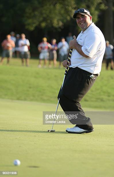 Kevin Stadler reacts to missing a putt on the 18th hole during a sudden death playoff in the final round of the Wyndham Championship at Sedgefield...