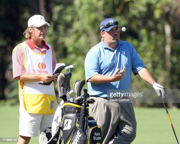 Kevin Stadler waits to hit his second shot to the 9th green on the Magnolia Course during the third round of The Childrens Miracle Network Classic...