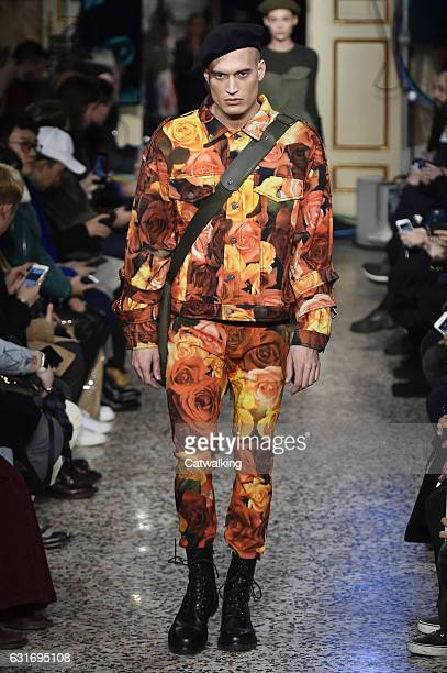 Kevin Staedler walks the runway at the Moschino Autumn Winter 2017 fashion show during Milan Menswear Fashion Week on January 14 2017 in Milan Italy