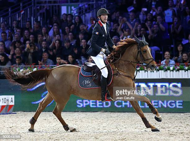 Kevin Staut of France competes in the Longines Speed Challenge show jumping event on day two of the Longines Paris Masters 2015 held at the...