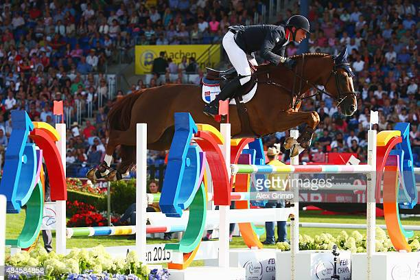 Kevin Staut of France competes on his horse Reveur de Hurtebise H D C during the MercedesBenz Prize Team Show Jumping competition on Day 9 of the FEI...