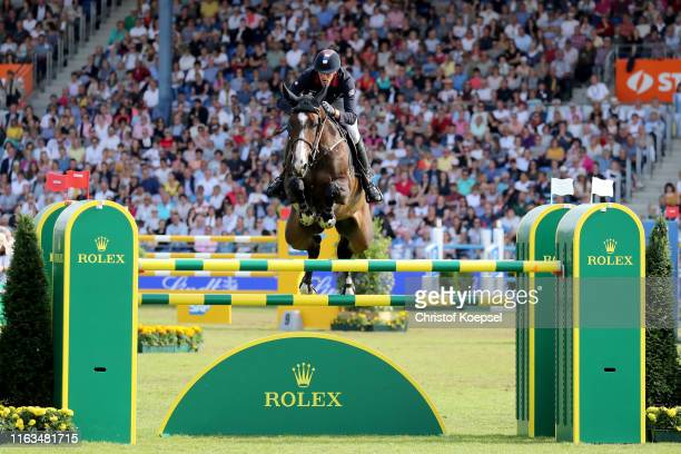 Kevin Staut of France rides on Urhelia Lutterbach during the Rolex Grand Prix of CHIO Aachen 2019 at Aachener Soers on July 21, 2019 in Aachen,...