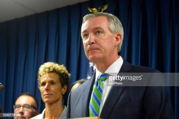 DA Kevin Steele sided by Andrea Constand holds a press conference after Bill Cosby is let out in handcuffs after hearing the sentence of three to ten...