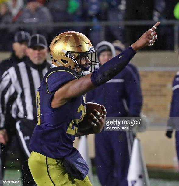 Kevin Stepherson of the Notre Dame Fighting Irish celebrates scoring the gamewinning touchdown against the Navy Midshipmen at Notre Dame Stadium on...