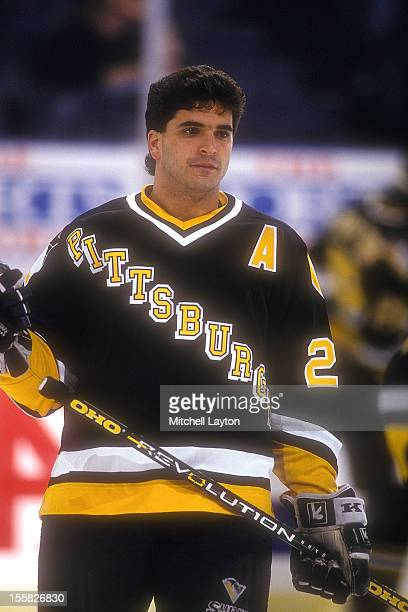 Kevin Stevens of the Boston Bruins looks on before a hockey game against the Washington Capitals on March 15 1996 at USAir Arena in Landover Maryland...